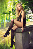 Beautiful blonde at the chateau lake Royalty Free Stock Photo