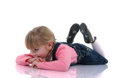 Beautiful blonde child 4. Beautiful blonde child with braids and pink dress sitting on the floor Stock Photo