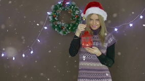 Beautiful blonde Christmas girl with red lantern on background of Christmas decorations stock video footage