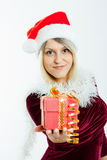 Beautiful blonde in a Christmas hat with gifts Royalty Free Stock Photos