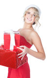 Beautiful blonde christmas woman holding gifts Royalty Free Stock Photos