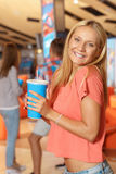 Beautiful blonde in the cinema Royalty Free Stock Photo