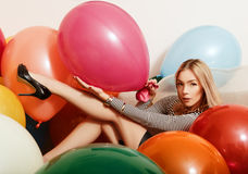 Beautiful blonde with color balloons Royalty Free Stock Image