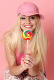 Beautiful blonde with the coloured candy Stock Photos