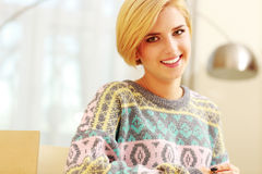Beautiful blonde in colourful sweater Stock Images