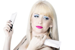 The beautiful blonde with cosmetics in hands Royalty Free Stock Image