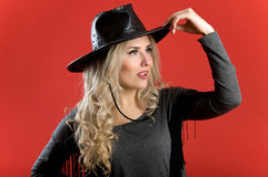 Beautiful blonde with curly hair wearing a cowboy hat Stock Photos