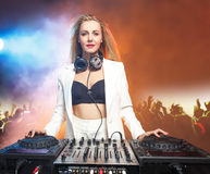 Beautiful blonde DJ girl on decks - the party, Stock Photography