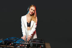 Beautiful blonde DJ girl on decks - the party Royalty Free Stock Photography
