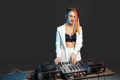 Beautiful blonde DJ girl on decks - the party Royalty Free Stock Image