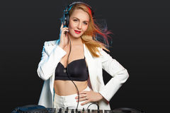 Beautiful blonde DJ girl on decks - the party Stock Image