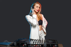 Beautiful blonde DJ girl on decks - the party Royalty Free Stock Photos