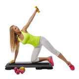 Beautiful blonde doing fitness exercises in studio Royalty Free Stock Photography