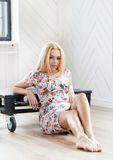 Beautiful blonde. In a dress royalty free stock photography