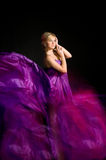 Beautiful blonde in a dress made of fabric flying Stock Images