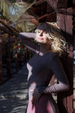 Beautiful blonde in dress walks in autumn Royalty Free Stock Photo