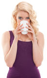 Beautiful blonde drinking coffee Stock Photography