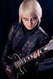 Girl with electric guitar Stock Photos