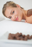 Beautiful blonde enjoying a chocolate beauty treatment Royalty Free Stock Photography
