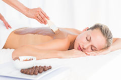 Beautiful blonde enjoying a chocolate beauty treatment Royalty Free Stock Photo