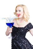Beautiful blonde enjoying a classy cocktail event. Beautiful blonde enjoying a blue alcoholic beverage during a classy cocktail event Royalty Free Stock Photography