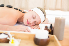 Beautiful blonde enjoying a hot stone massage Royalty Free Stock Photo