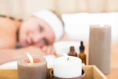 Beautiful blonde enjoying a hot stone massage Royalty Free Stock Photography