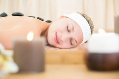 Beautiful blonde enjoying a hot stone massage Royalty Free Stock Photos