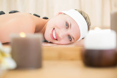 Beautiful blonde enjoying a hot stone massage Stock Photo