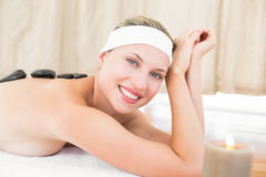 Beautiful blonde enjoying a hot stone massage Stock Image