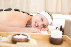 Beautiful blonde enjoying a hot stone massage Stock Images