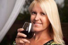 Beautiful Blonde Enjoying Wine Stock Image