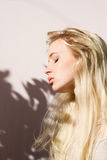 Beautiful blonde enyoing sunlight with closed eyes Royalty Free Stock Photos