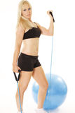 Beautiful blonde exerciser Stock Images
