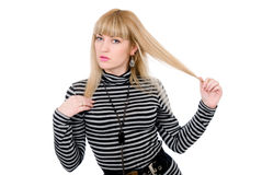 Beautiful blonde extending hair aside Royalty Free Stock Image