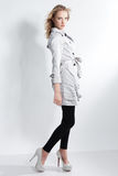 Beautiful blonde fashion girl in a gray coat Royalty Free Stock Images