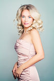 Beautiful Blonde Fashion Model Woman With Curly Hair Stock Photo