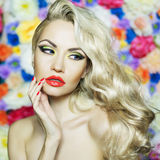 Beautiful blonde. Fashion portrait of beautiful blonde on flower background stock photos