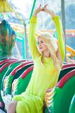 Beautiful blonde fashion woman in amusement park summer day royalty free stock photography