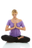 Beautiful blonde female doing yoga isolated on white Stock Photos