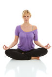 Beautiful blonde female doing yoga isolated on white Royalty Free Stock Photography