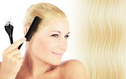 Beautiful blonde female dyeing hair Royalty Free Stock Images