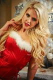 Beautiful blonde female model dressed as Sexy Santa Helper. Sensual girl for Christmas Royalty Free Stock Photography
