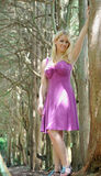 Beautiful blonde female model in plum sundress Royalty Free Stock Photos