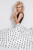 Beautiful blonde female model in a polka dots wedding dress Stock Photography