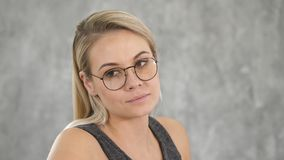 Beautiful blonde female with puzzled expression. royalty free stock image