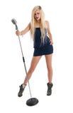 Beautiful blonde female singer in blue dress Royalty Free Stock Image