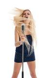 Beautiful blonde female singer in blue dress Stock Photos