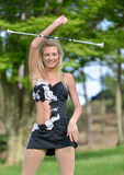 Beautiful blonde female twirler or majorette performs Royalty Free Stock Image