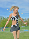 Beautiful blonde female twirler or majorette performs Royalty Free Stock Images